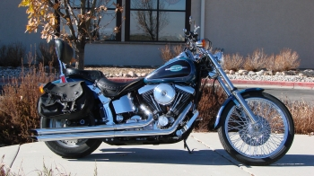 1996  FXSTC  TEAL AND BLACK TWO TONE WITH 50K MILES.OPTIONS:Chrome front end, performance air cleaner, performance exhaust, sissy bar/backrest, saddle bags