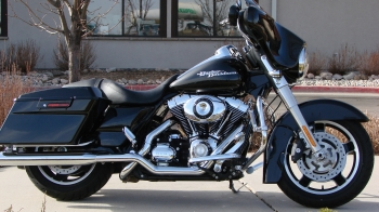 "2009 FLHX STREET GLIDE WITH 27K MILES IN VIVID BLACK.OPTIONS:Performance air cleaner, true-dual Rinehart performance exhaust, 12"" ape hanger bars, 4 point docking hardware"